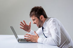 Emotional man and laptop Stock Photography