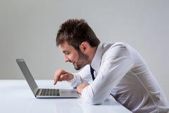 Emotional man and laptop Stock Photos