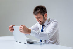 Emotional man and laptop Royalty Free Stock Photos