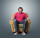 Emotional man listens to music on headphones Royalty Free Stock Images