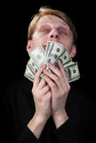 Emotional the man and money. To a black background Stock Photos