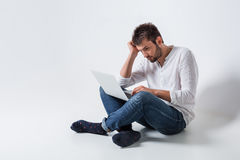 Emotional man and notebook Royalty Free Stock Photos
