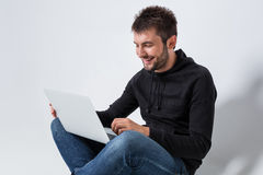 Emotional man and notebook Royalty Free Stock Images