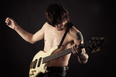 Emotional man playing bass guitar Stock Photo