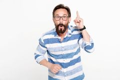 Emotional man pointing his finger up while getting good idea royalty free stock photography