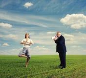 Emotional man screaming at calm woman. Emotional men screaming at calm women in the field Stock Photography