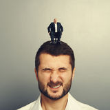Emotional man with small happy boss Royalty Free Stock Image