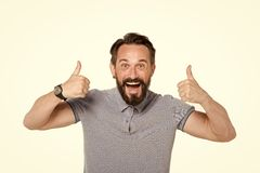 Emotional man with two thumbs up isolated on white background. Excited bearded guy happy face emotion. Thumbs up by both hands. stock images