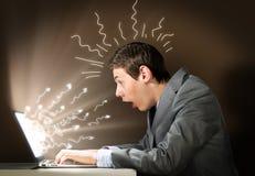 Emotional man using laptop Royalty Free Stock Photography