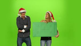 Emotional man and woman: new year eve. green stock footage