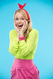Emotional model in bright multi-colored clothes Stock Image