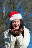 Emotional Mrs. Santa in park Royalty Free Stock Photography