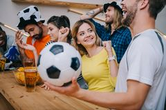 emotional multicultural group of friends watching soccer match stock image