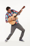 Emotional musician playing his guitar. Stock Images