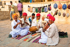 Emotional musicians play indian music on instruments Royalty Free Stock Photo