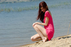 Emotional picture of a cute lady near a lake Stock Photo