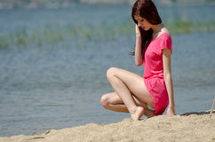 Emotional picture of a cute lady near a lake Stock Photography