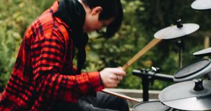 Emotional playing on electronic drums in the fresh air. stock video