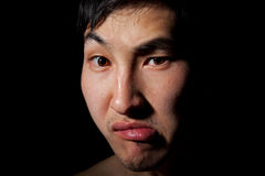 Emotional portrait. The obverse portrait of the young Asian man which poses a mug Stock Image