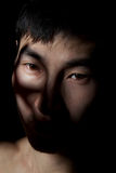 Emotional portrait. The obverse portrait of the young Asian man which poses a mug Royalty Free Stock Photos