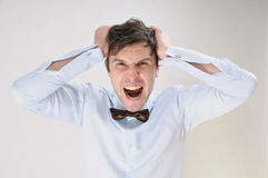 Emotional portrait of attractive screaming man on white backgrou Royalty Free Stock Images