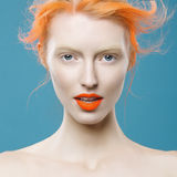Emotional portrait of beautiful girl with orange hair royalty free stock images
