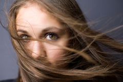 Emotional portrait of a beautiful young brunette. Royalty Free Stock Photography