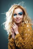 Emotional portrait of beauty girl with original makeup. Emotional Portrait of beauty woman with original makeup Stock Photo