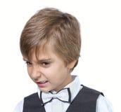 Emotional portrait of evil teen boy. Stock Photos