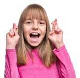 Emotional portrait of girl. Close-up portrait of attractive caucasian hopeful girl crossing her fingers. Beautiful human face expression and emotions. Child Royalty Free Stock Photos