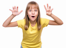 Emotional portrait of girl. Half-length emotional portrait of caucasian girl wearing yellow t-shirt. Funny cute child looking at camera with her hands in Royalty Free Stock Photography