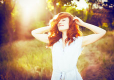 Emotional portrait of happy beautiful woman with red curly hair Royalty Free Stock Photo