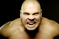 Emotional portrait of muscular aggressive man Royalty Free Stock Photos