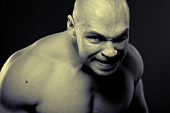 Emotional portrait of muscular aggressive man Royalty Free Stock Images