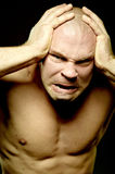 Emotional portrait of muscular aggressive man Stock Images