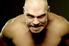 Emotional portrait of muscular aggressive man Stock Photo