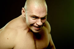 Emotional portrait of muscular aggressive man Royalty Free Stock Photo