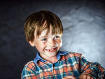 Emotional portrait of red-haired boy Stock Image