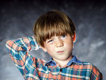 Emotional portrait of red-haired boy Stock Photo