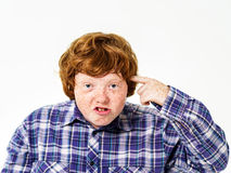 Emotional portrait of red-haired boy Stock Images