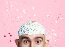 Emotional portrait of surprised bald man with easter cake on his head. Funny Easter concept royalty free stock photos