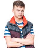 Emotional portrait of teen boy. Emotional portrait of caucasian teen boy. Serious, sad or thoughtful handsome young teenager with arms folded. Studio shot Royalty Free Stock Image