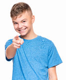 Emotional portrait of teen boy. Half-length emotional portrait of caucasian teen boy wearing blue t-shirt. Funny teenager pointing at camera choosing you Stock Photos