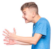 Emotional portrait of teen boy. Profile of the shouting boy - emotional portrait of caucasian teen boy wearing blue t-shirt. Furious teenager screaming with Stock Photography