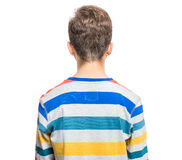 Emotional portrait of teen boy. Rear view of caucasian teen boy. Back funny cut teenager, isolated on white background Stock Photography