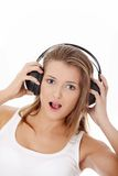 Emotional portrait of teen girl listening music Stock Images