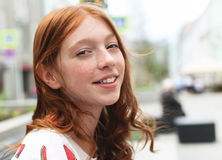 Emotional portrait of a young red-haired girl. Emotional portrait of a young red-haired girl in the city Royalty Free Stock Images