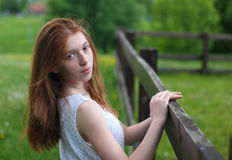Emotional portrait of a young red-haired girl. Emotional portrait of red-haired girl in the park Royalty Free Stock Image