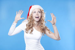 Emotional pretty Santa girl Royalty Free Stock Photo