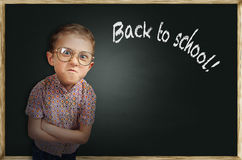 Emotional pupil boy near chalkboard Royalty Free Stock Images
